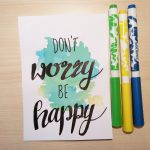 "Aquarellkarte mit Handlettering ""Don't worry be happy"""